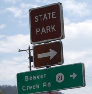 State Park sign in Huntersville, WV directing to Watoga