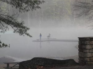 Fisherman in fog on Watoga Lake in February