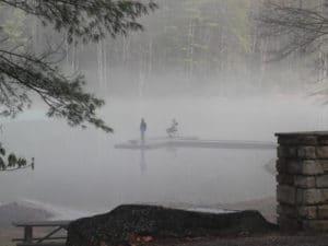 Fisherman in fog on Watoga Lake in February