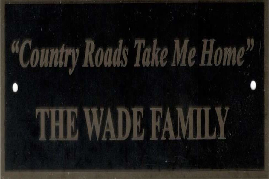 This image is displaying the Wade family's inscription on a plaque for a park bench located near the Fred E. Brooks Memorial at the Arboretum at Watoga State Park near Marlinton, West Virginia. The Wades have visited Watoga for decades. We love the inscription on the Wade's park bench and so would John Denver. | 📸: Watoga State Park Foundation, Inc.