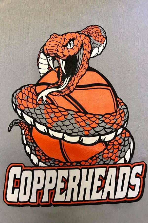 """We are the Copperheads -- the mighty, mighty Copperheads"" This copperhead twists its way around and around a basketball. 