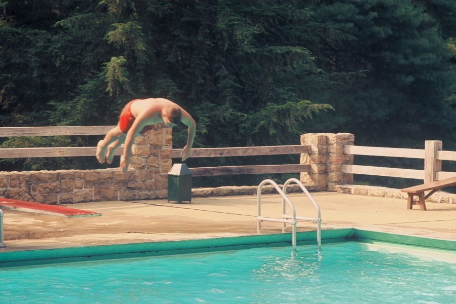 David Bott in flight from the diving board at the swimming pool, circa 1968. | 📸: Leonard Bott