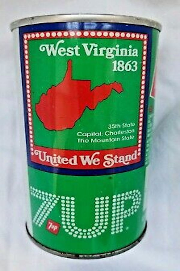 A West Virginia 7 Up cA West Virginia 7 Up can released in advance of the Fourth of July, 1976. Photo courtesy of ebay.comPhoto courtesy of ebay's Image Majick. The name West Virginia is comprised of a square pattern that contains white circular dots blanded over a solid red border. United We Stand is highlighted at the bottom of the square (in white letters) over a red color. The colors are the standard red, white and blue overlaying 7 Up's standard green color.