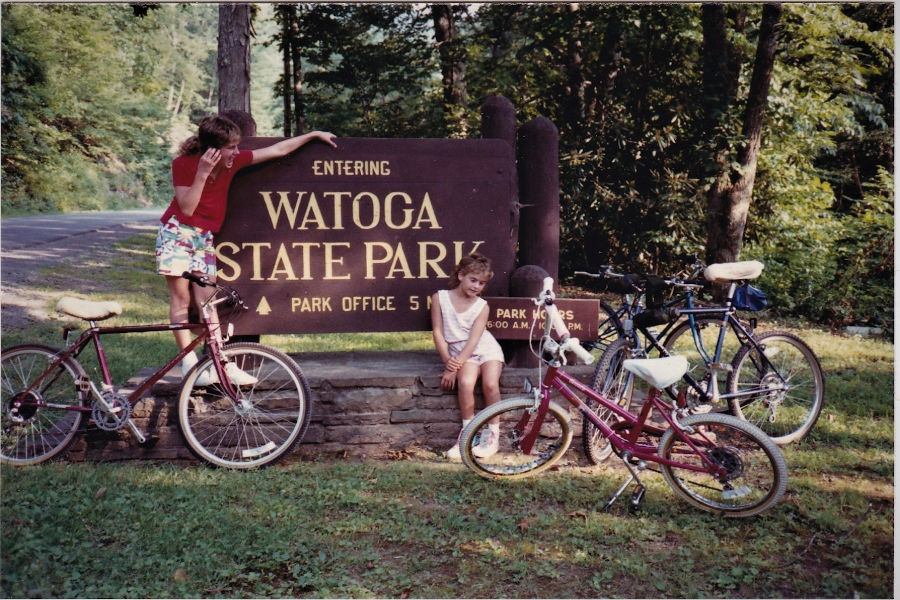 These two sisters with their bicycles pose at the Watoga State Park entrance sign. Sisters Rachelle (L) and Sara (R) had more than one Top 10 List when visiting Watoga as a family each year as part of the Bott family.  📸: David Bott, 1987.