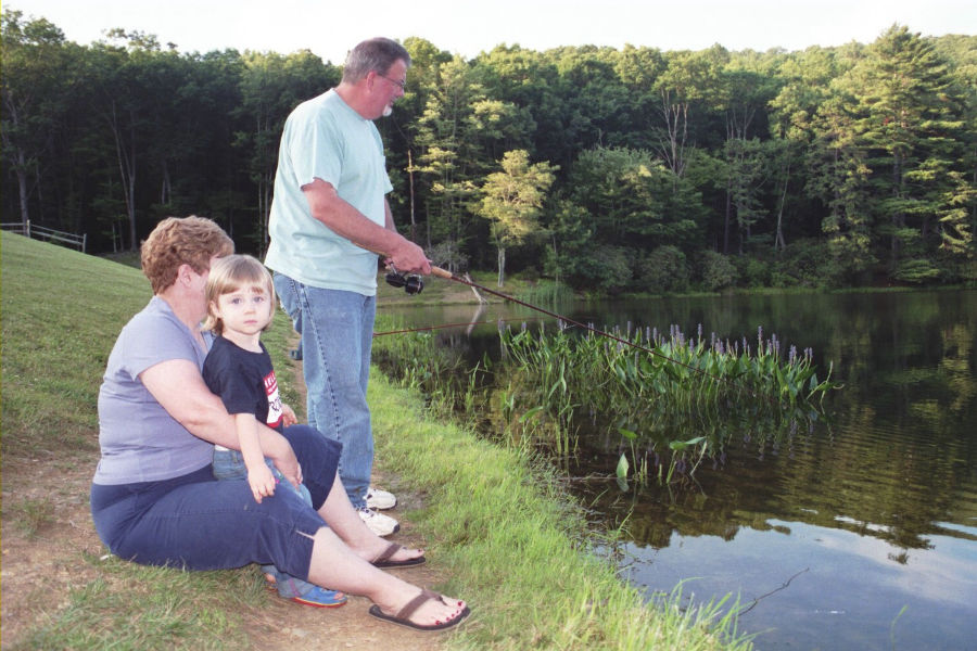 My parents, David and Donna Bott, enjoying a summer day 2007 with their granddaughter, Belle (my daughter), at Watoga Lake. 📸: Rachelle Bott Beckner.