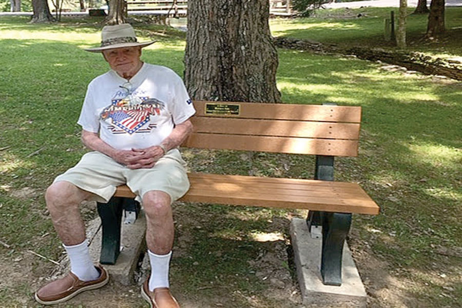 Richard Dale, superintendent at Watoga from 1966-1975, enjoys a sun-filled summer day on his bench. 📸: Rose Clark, June 2020.