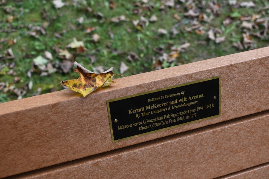 Situated near the CCC statue is Kermit and Arenna McKeever's bench as part of the Watoga State Park Bench Program. 📸: John C. Dean, September 16, 2020