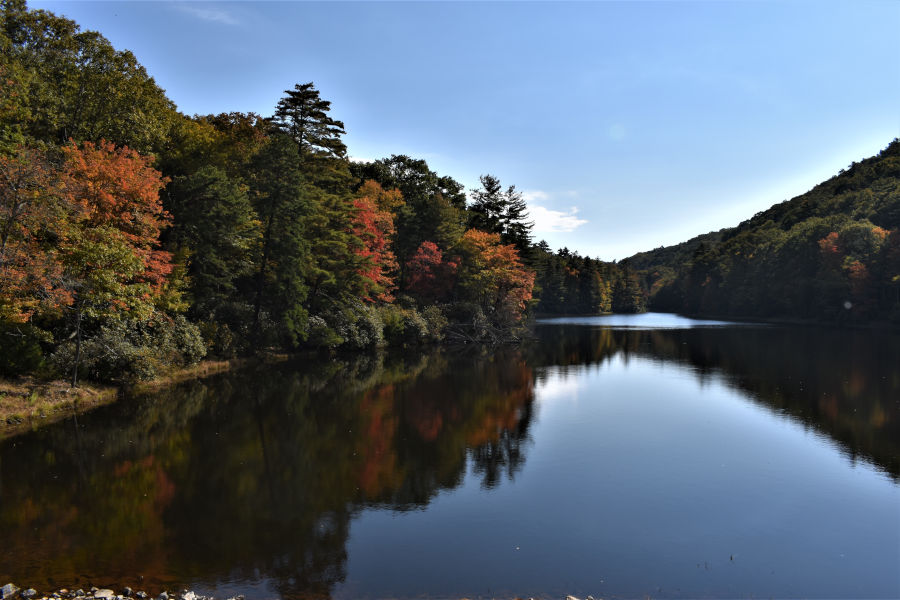 Hues of orange and red signal the beginning of fall at Watoga Lake. 📸: John C. Dean, October 7, 2020.