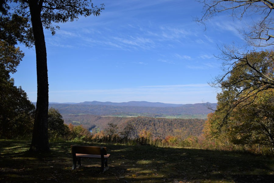 You can see for miles and miles with this fall scene. This is just one of the many stunning views at Ann Bailey Lookout Tower. In the distance are the Greenbrier River Valley and the Little Levels District of Pocahontas County. Bench was donated by the Young family. Photo by John Dean©.