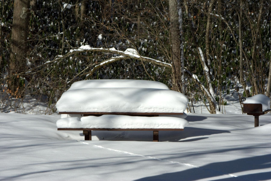 "At a picnic table at Watoga, more than 18"" of snow pile atop the table. When it snows at Watoga, scenes like this one are common. Photo by Stanley Clark©."