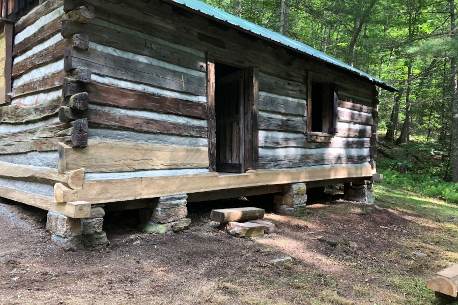 """An """"after"""" photo of this log cabin shows the extensive foundation work that was necessary to save this historic cabin from certain ruin. Photo by The Watoga State Park Foundation."""