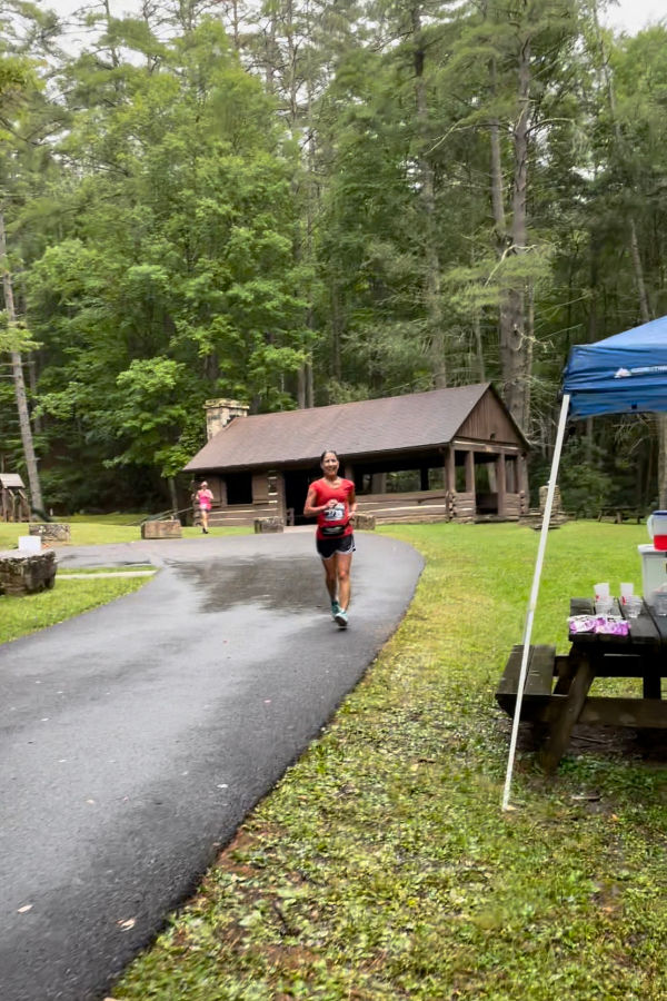 Near the picnic shelter at Watoga State Park, this runner sprints toward an aid station.