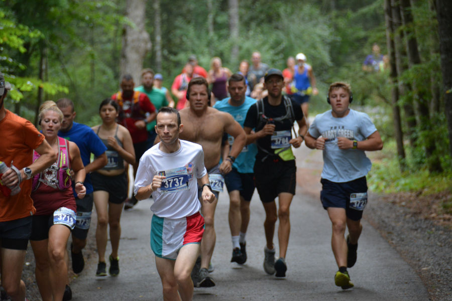 """Pastor John Sowers, No. 3737 of the First Christian Church (Disciples of Christ) at """"home and at peace"""" at Watoga's 2021 Mountain Trail Challenge Half-Marathon Race. Photo by Brian Hirt."""